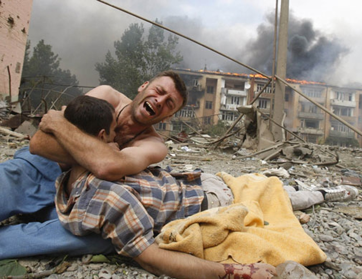 A Georgian clutches a relative's body after a Russian plane bombed an apartment block in Gori, 50 miles from Tbilisi, during the conflict over South Ossetia